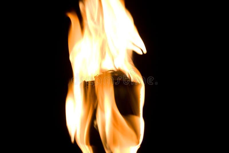 在火炬的背景黑色火火焰 免版税库存图片