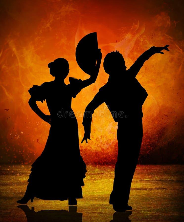 在火背景的西班牙佛拉明柯舞曲舞蹈家夫妇 库存图片