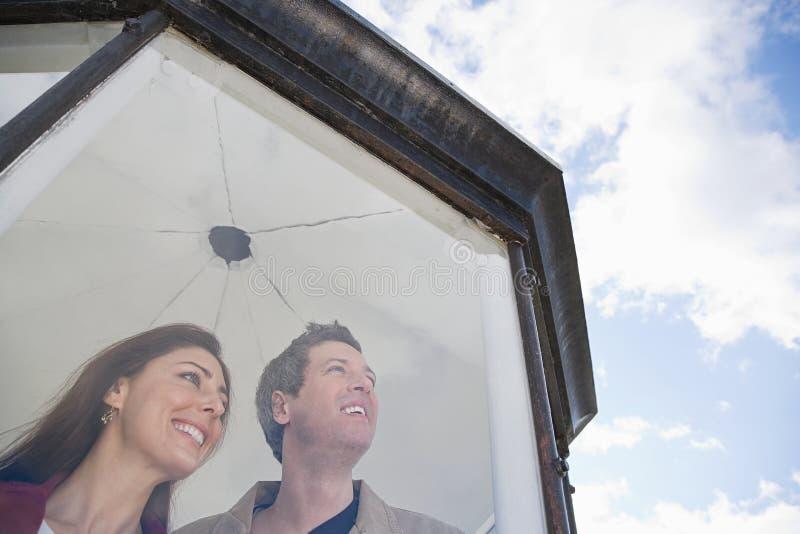 Download 在灯塔的一对夫妇 库存照片. 图片 包括有 吸气器, 个性, 被砍的, 目录, 旅途, 成人, 云彩, 丈夫 - 62534174