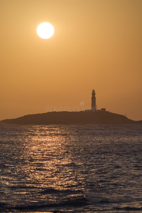 在灯塔的日落 图库摄影
