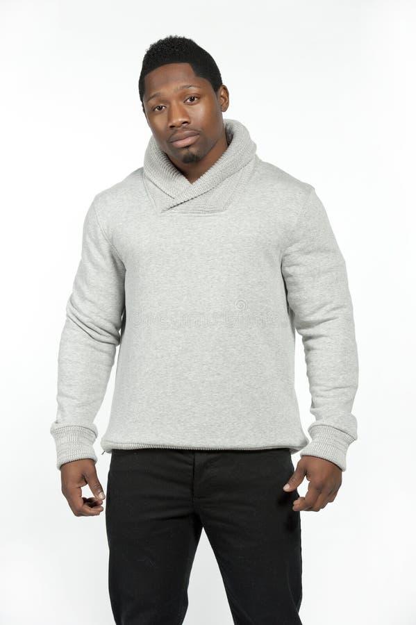 在灰色毛线衣的非裔美国人的男性 库存照片