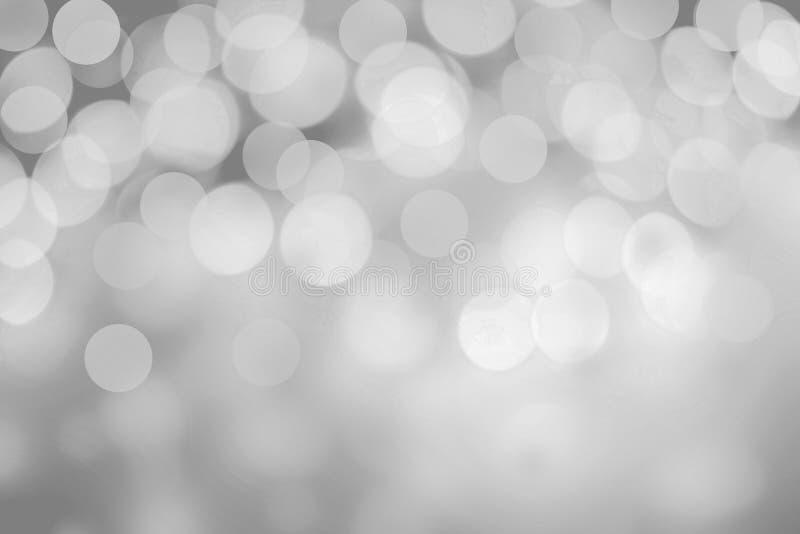 在灰色背景的闪耀的光 闪烁圣诞节摘要 图库摄影