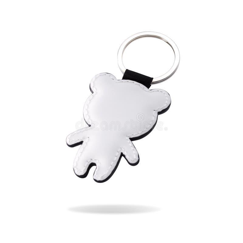 在熊形状的皮革钥匙圈在被隔绝的白色背景 您的设计的钥匙型片链子 裁减路线或删去对象 库存照片
