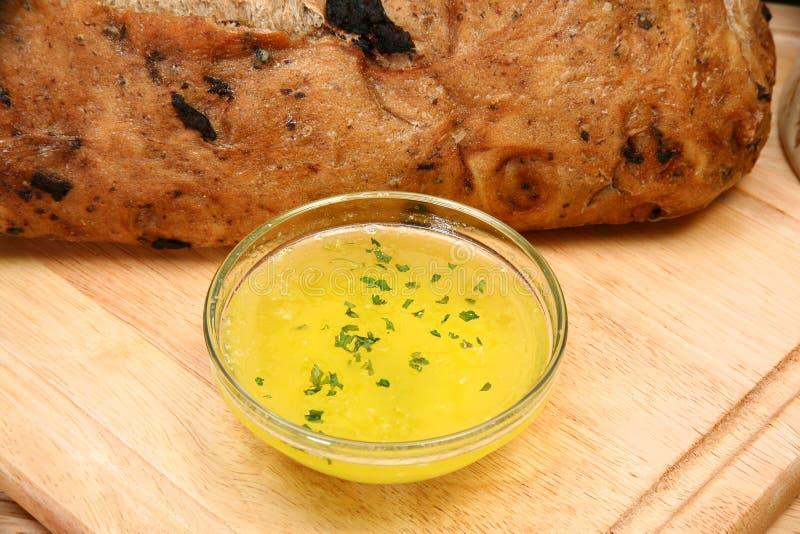 在熔化的大蒜涂黄油 库存图片