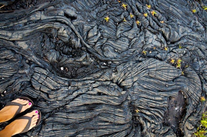 在熔岩荒野的脚 免版税图库摄影