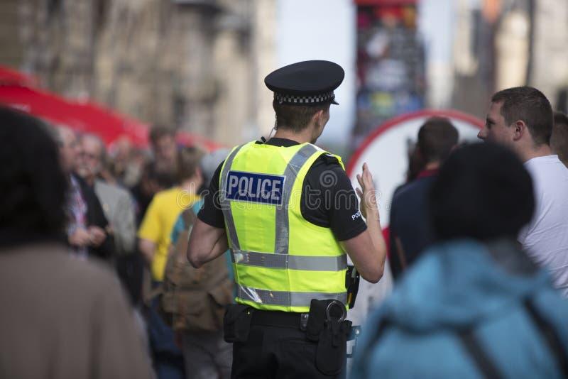 在爱丁堡边缘节日期间,维持巡逻治安, 2014年 免版税库存图片