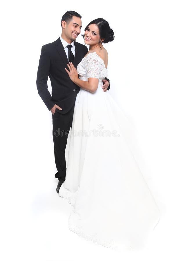 在爱的愉快的婚礼夫妇 库存照片