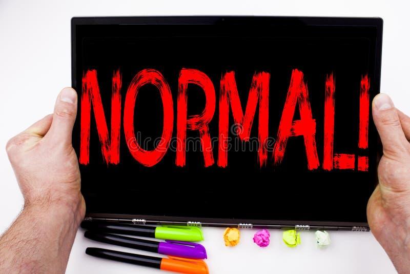 在片剂写的正常文本,计算机在有标志的,笔,文具办公室 信心的反常诺马企业概念 免版税库存图片