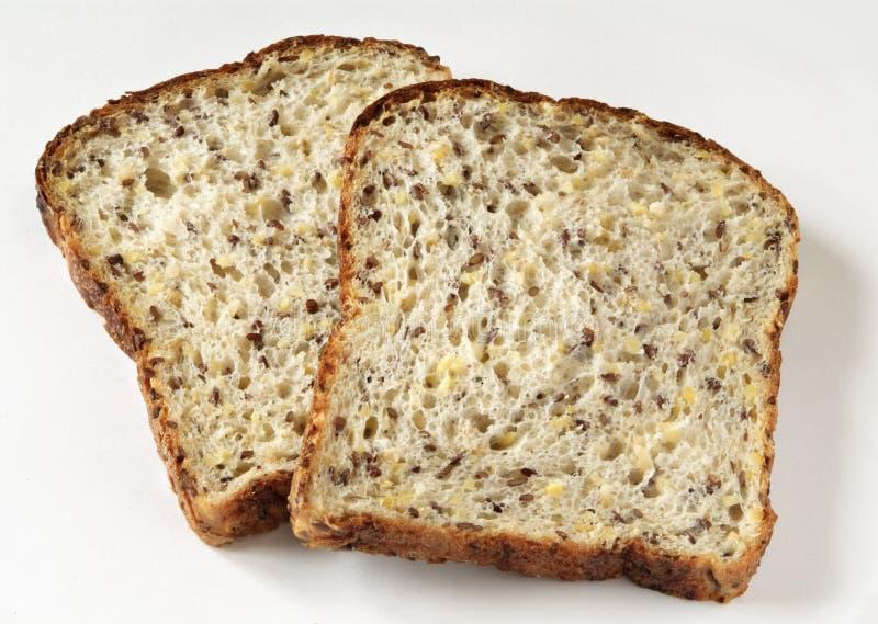 在片式上添面包 库存图片