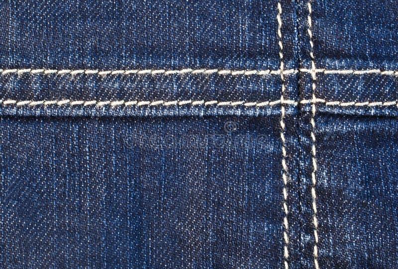在牛仔布的缝 免版税库存照片