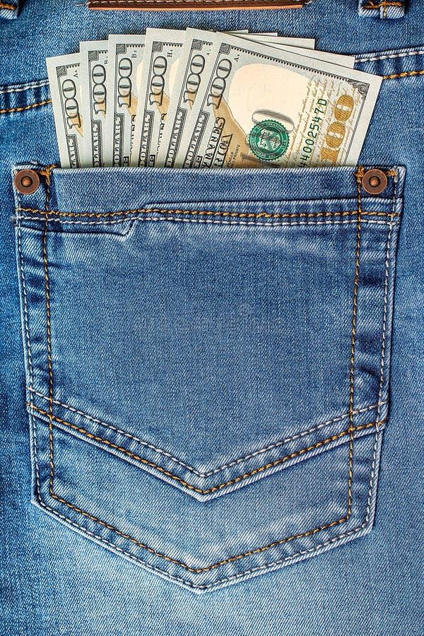 在牛仔裤口袋的美元钞票 库存图片