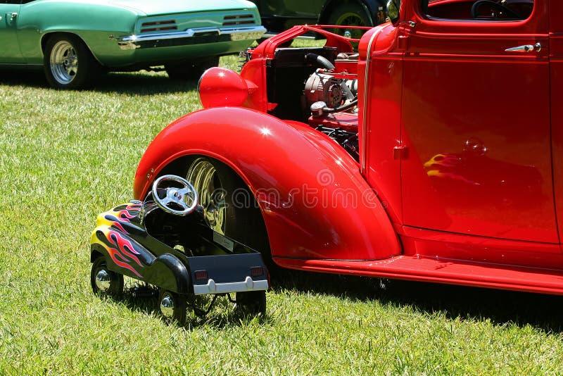 在玩具旁边的汽车经典之作 库存照片