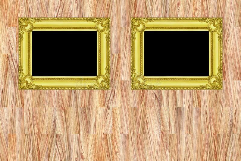 在现代木墙壁背景的两个金框架 皇族释放例证
