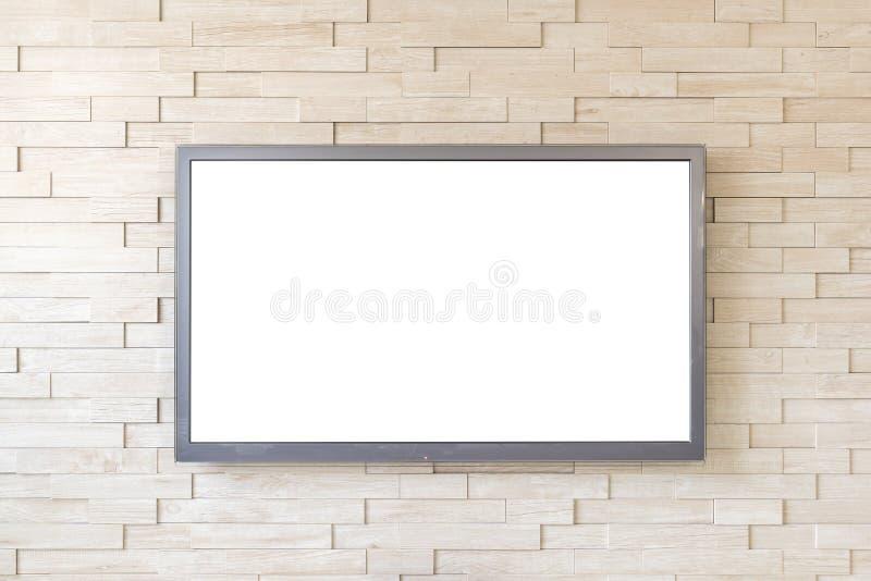 在现代砖墙背景的电视显示与白色屏幕 免版税库存照片