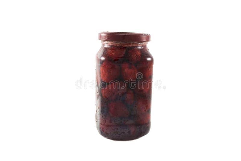 在玻璃瓶子装于罐中的大草莓隔绝了 库存图片