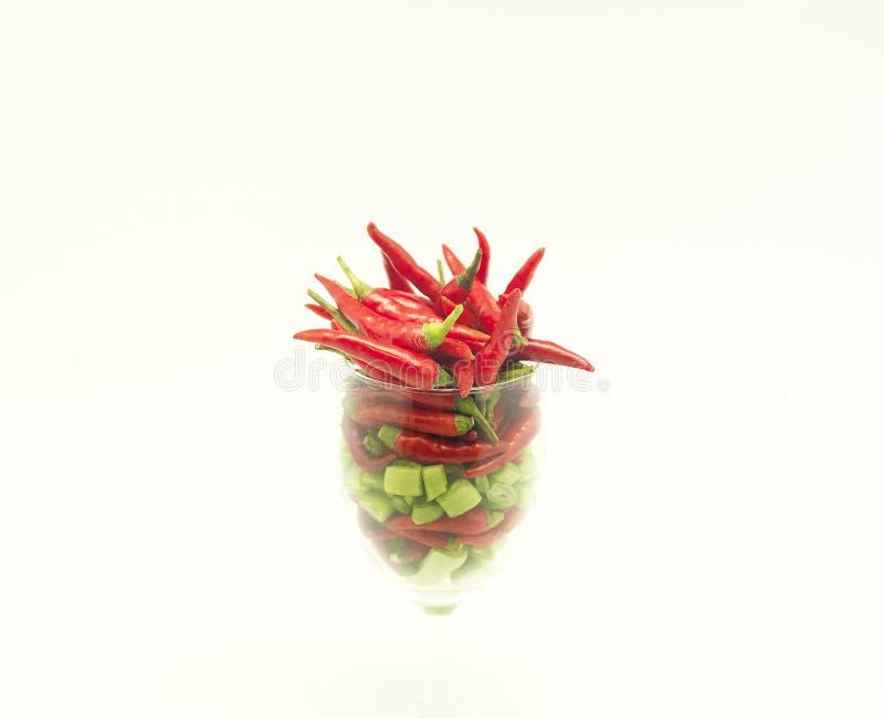 在玻璃的辣椒 免版税库存照片