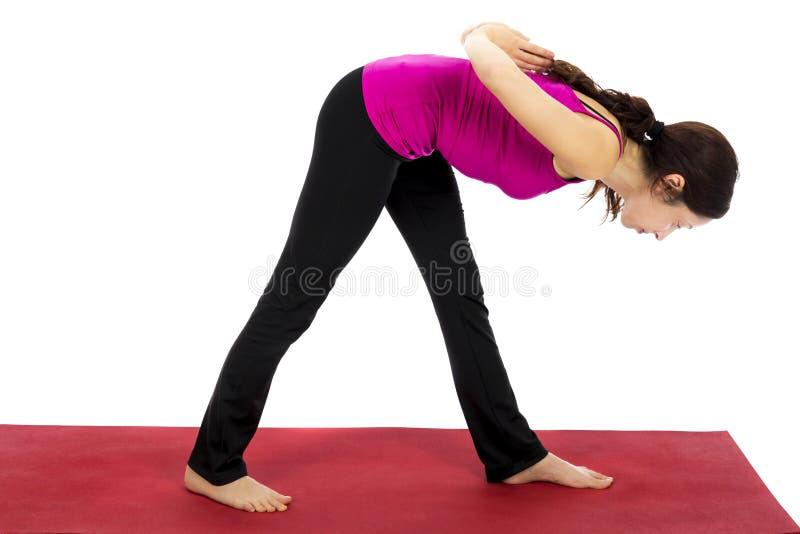 在瑜伽的强烈的旁边舒展姿势 免版税库存照片