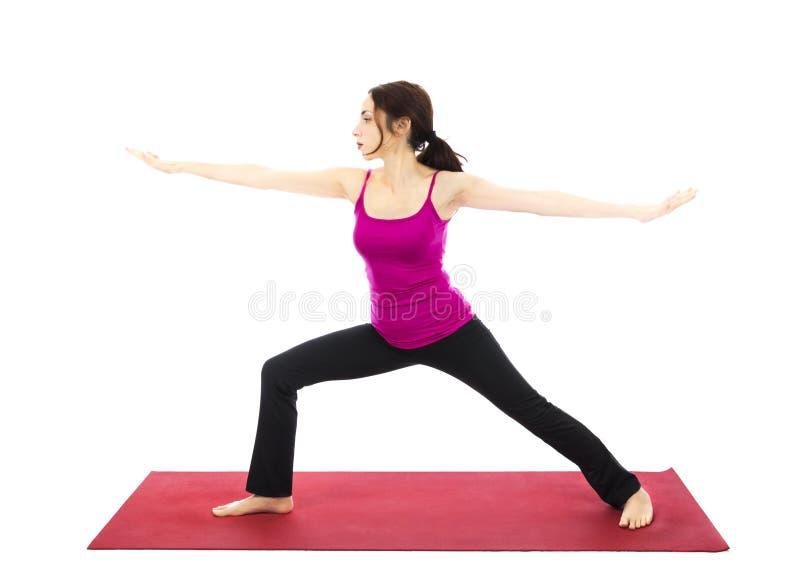 在瑜伽的战士II姿势 免版税库存图片