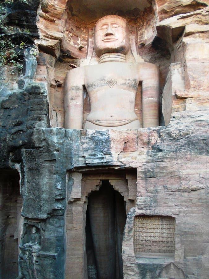 在瓜廖尔/印度的岩石的古老Buddhas 免版税库存图片