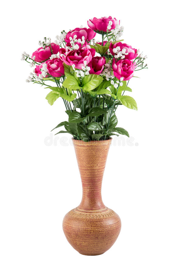 在瓦器花瓶的塑料花 免版税库存照片