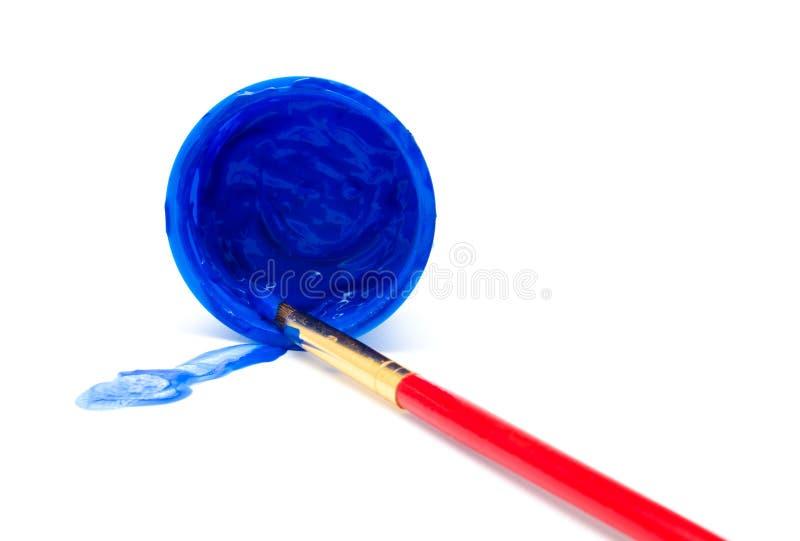 在瓶子和刷子的蓝色颜色油漆 图库摄影