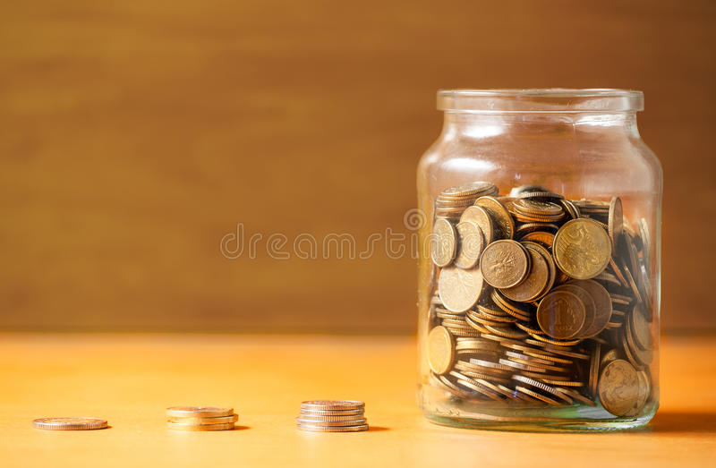 在瓶子的储款 免版税库存图片