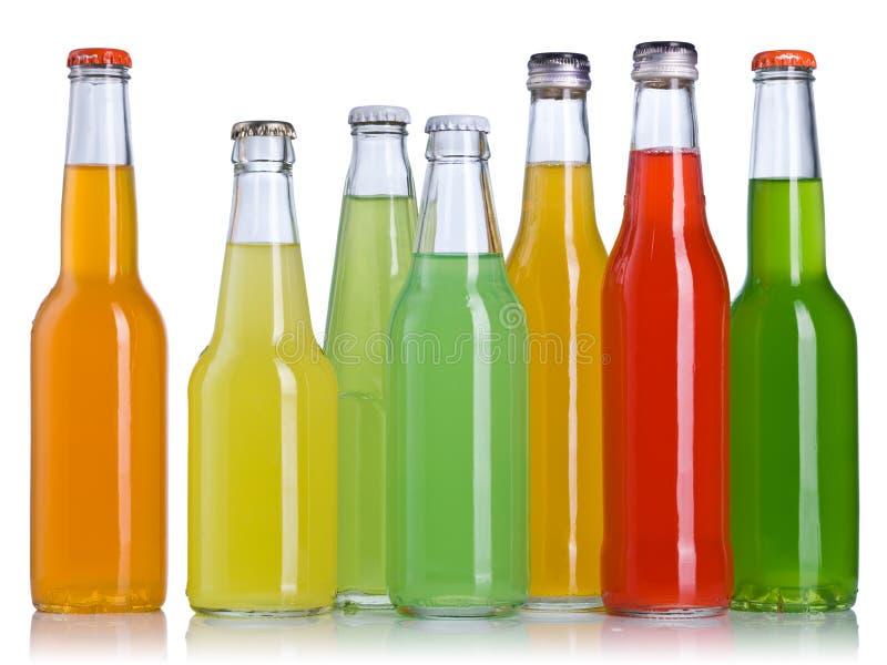 在瓶的五颜六色的饮料 免版税库存照片