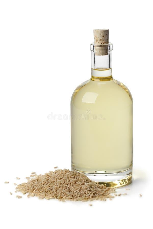 在瓶的米糠油 免版税库存图片