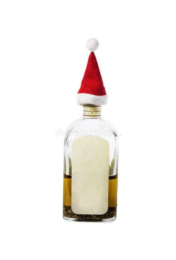 在瓶颈的小的圣诞老人的盖帽与强的酒精 免版税库存图片