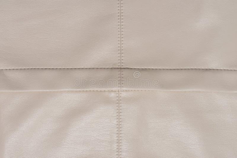 在甚而四个片断划分的皮革米黄表面 图库摄影