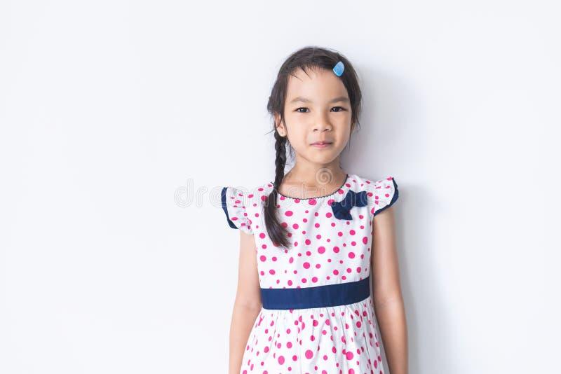 在甜葡萄酒礼服的小女孩画象 库存图片