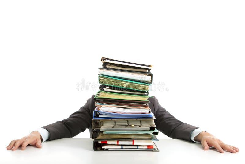在生意人隐藏的文书工作之后 免版税库存图片