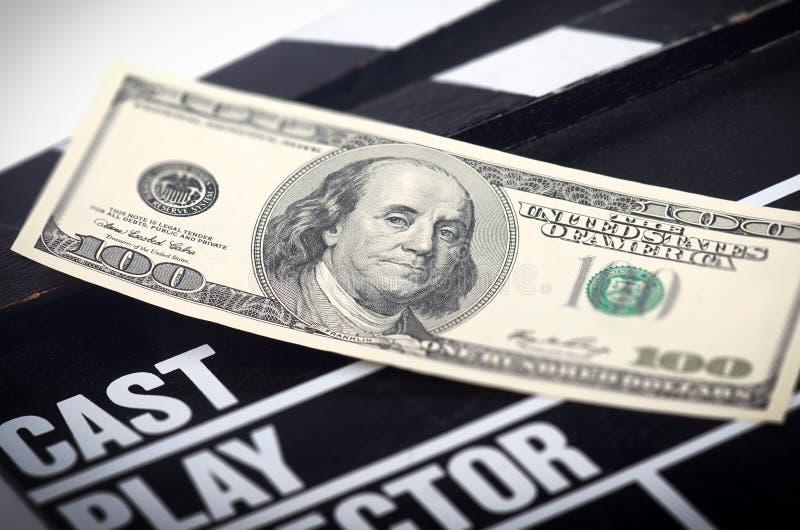 在电影拍板的金钱 免版税图库摄影