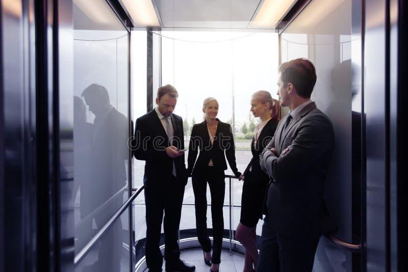 在电梯的企业队 免版税库存照片