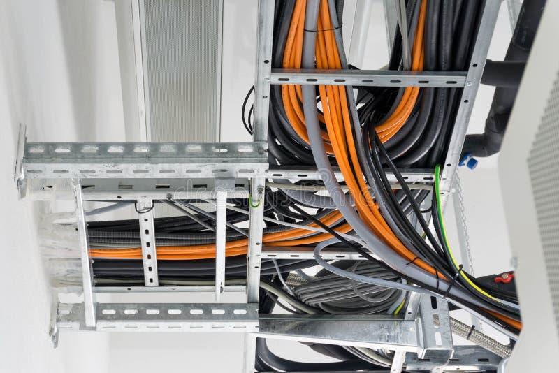 在电缆管或渠道的不同的缆绳 免版税库存照片