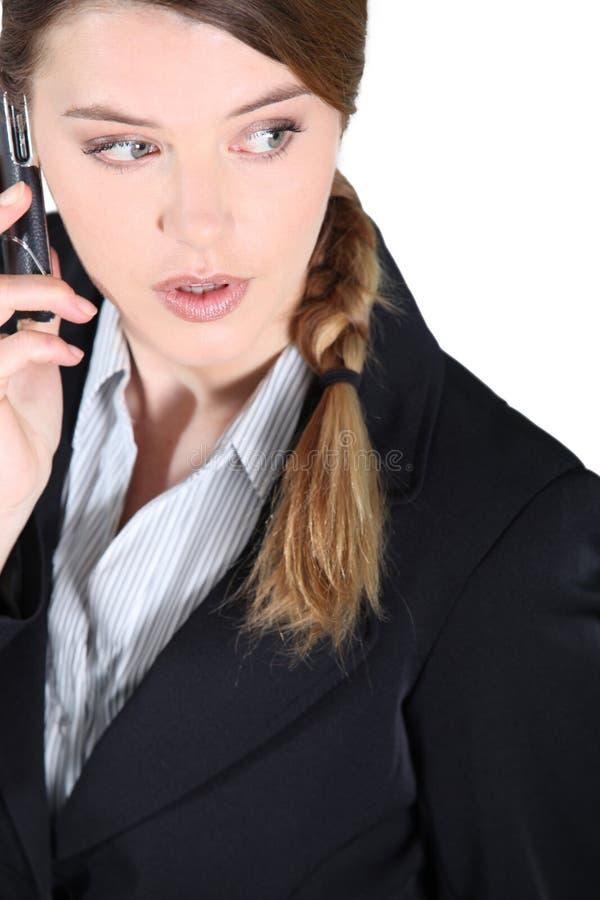 在电话冲击的妇女 免版税图库摄影