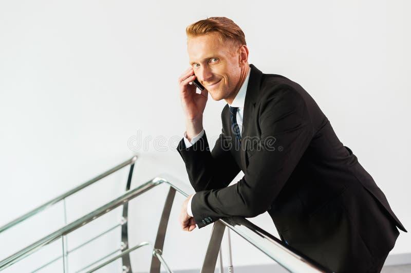 在电话的事务 免版税库存照片