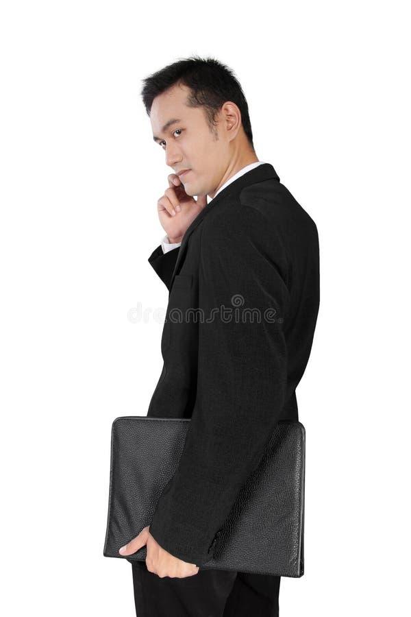 在电话的常设sucessful商人,隔绝在白色 免版税图库摄影