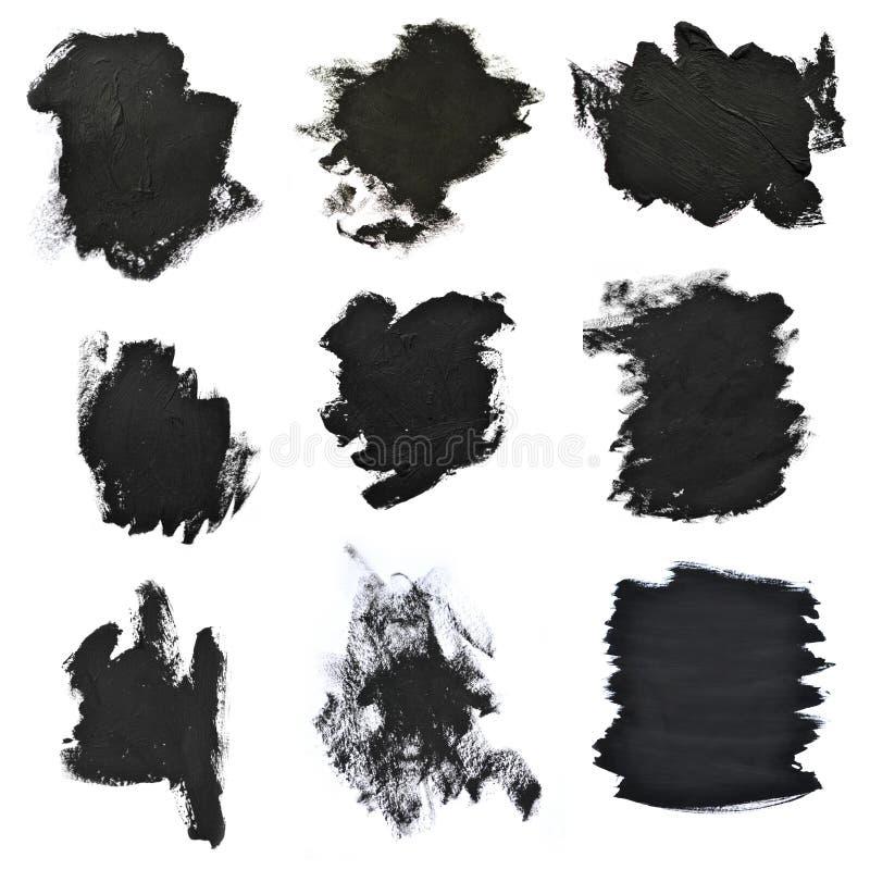 在白皮书的集合黑刷子冲程 免版税库存图片