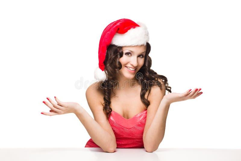 在白色以空查出的美丽的圣诞老人女孩 库存照片