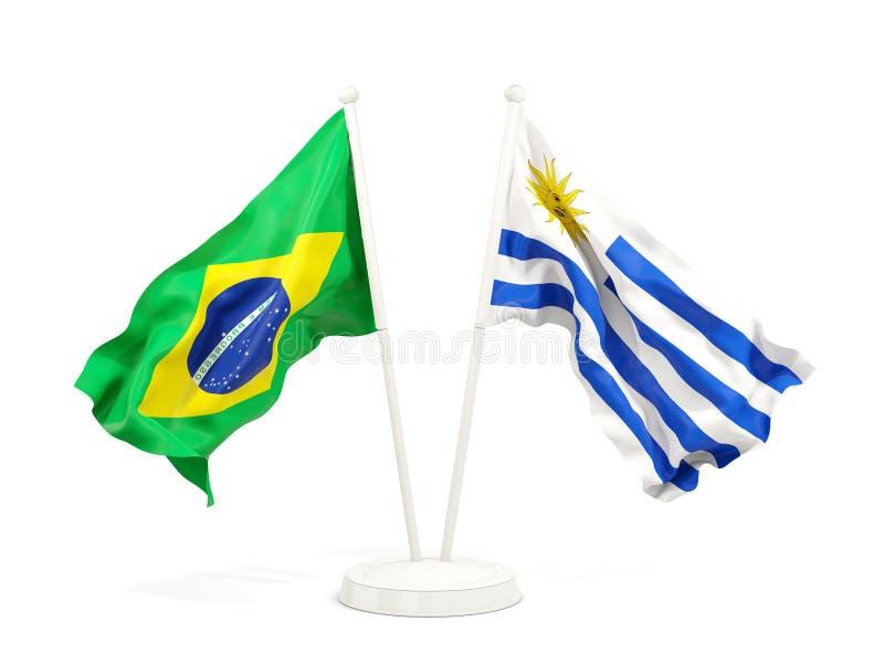 在白色和乌拉圭的隔绝的两面挥动的旗子巴西 向量例证