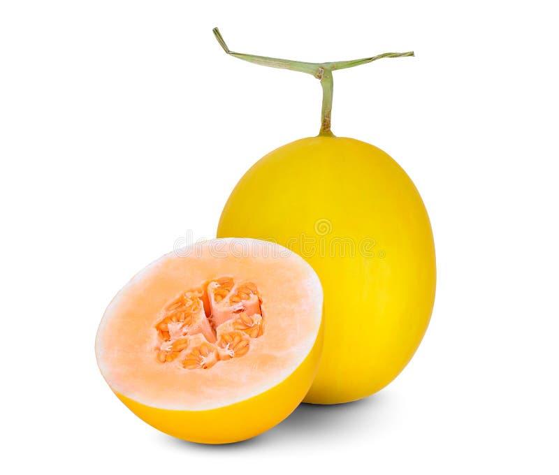 在白色和半黄色甜瓜瓜隔绝的整体 免版税图库摄影
