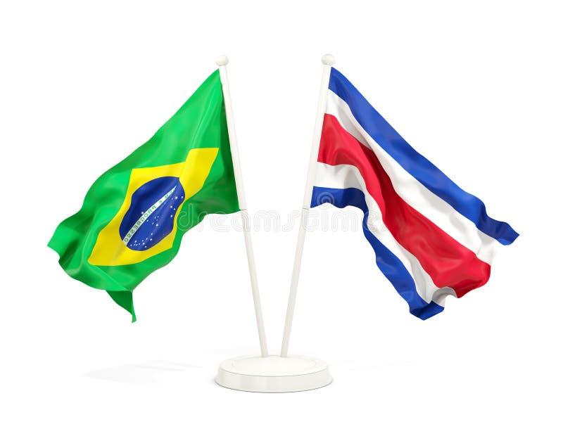 在白色和哥斯达黎加的隔绝的两面挥动的旗子巴西 皇族释放例证