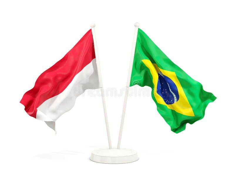 在白色和巴西的隔绝的两面挥动的旗子印度尼西亚 皇族释放例证