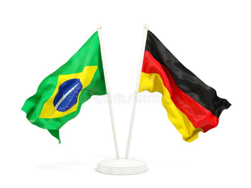 在白色和德国的隔绝的两面挥动的旗子巴西 皇族释放例证
