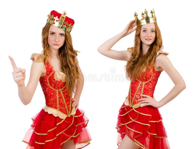 在白色和红色礼服隔绝的公主佩带的冠 免版税库存图片