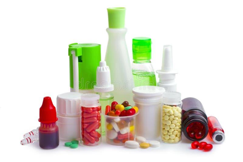 在白色和药片隔绝的医学瓶 库存照片