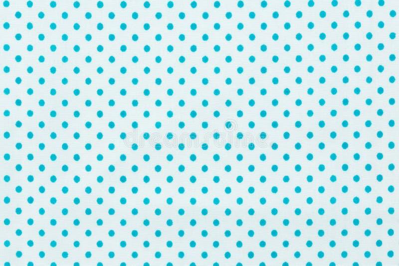 在白色和蓝色样式织品的圆点 图库摄影