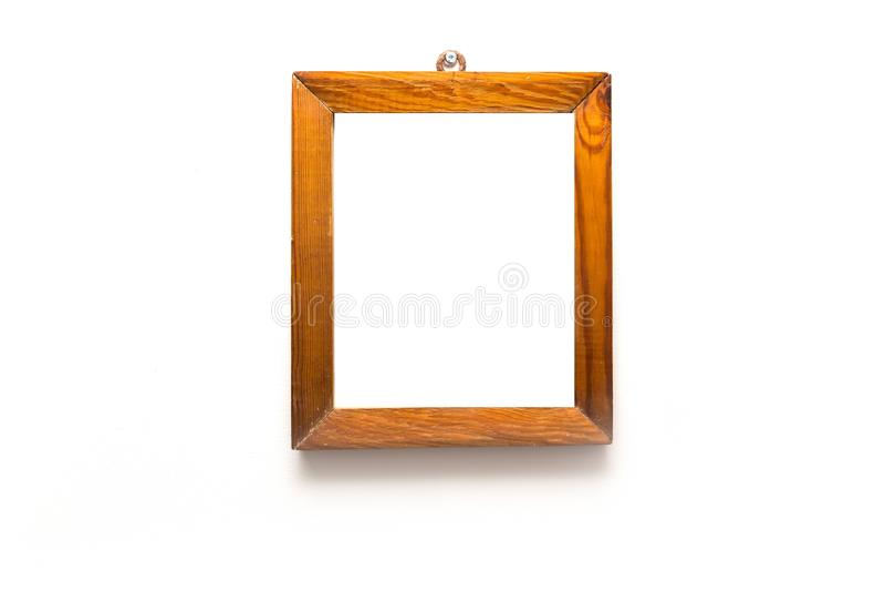 在白色墙壁上的木制框架 免版税库存照片