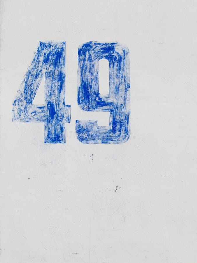在白色墙壁上的第49 库存图片